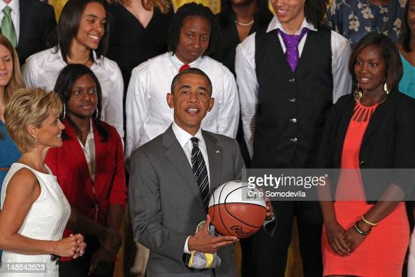 S President Barack Obama holds a basetball given to him by the 2012 NCAA Women's Basketball champion Baylor Bears and their Head Coach Kim Mulkey in...
