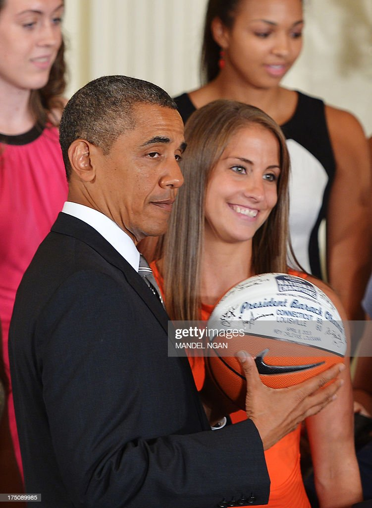 US President Barack Obama holds a basketball presented to him during an event in honour of the 2013 NCAA Womens Basketball Champions, the University of Connecticut Huskies, in the East Room of the White House on July 31, 2013 in Washington, DC. AFP PHOTO/Mandel NGAN