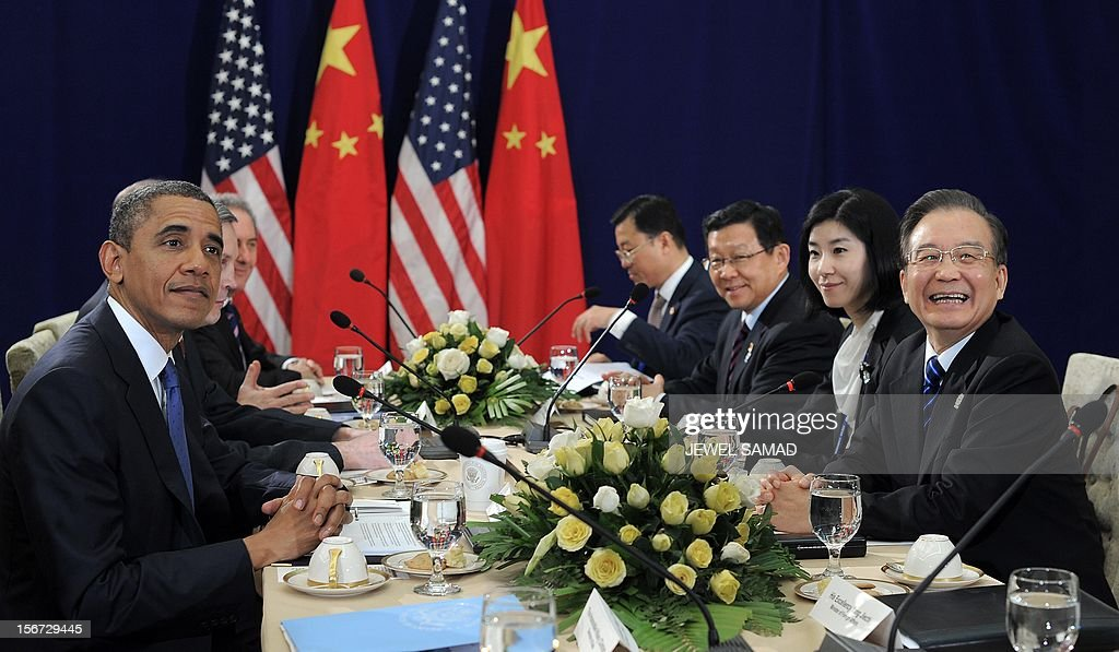 US President Barack Obama (L) holds a bilateral meeting with Chinese Premier Wen Jiabao (R) during a bilateral meeting on the sidelines of the East Asian Summit at the Peace Palace in Phnom Penh on November 20, 2012. During the two-day East Asia Summit in Phnom Penh, Obama was scheduled to hold talks with the leaders of the 10-member Association of Southeast Asian Nations (ASEAN) along with Chinese Premier Wen Jiabao and Japan's Yoshihiko Noda. AFP PHOTO / Jewel Samad
