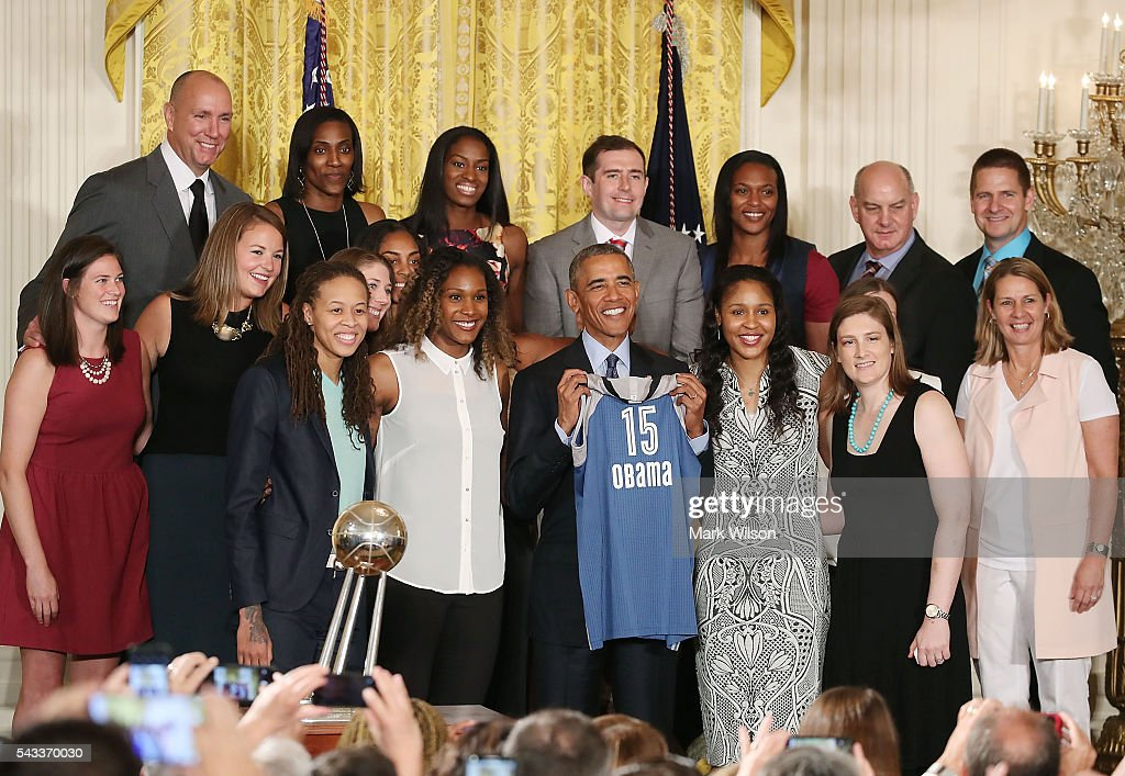 US President <a gi-track='captionPersonalityLinkClicked' href=/galleries/search?phrase=Barack+Obama&family=editorial&specificpeople=203260 ng-click='$event.stopPropagation()'>Barack Obama</a> holds a jersey while posing for a picture during an event to honor the Minnesota Lynx team for its 2015 WNBA championship victory, in the East Room at the White House June 27, 2016 in Washington, DC.