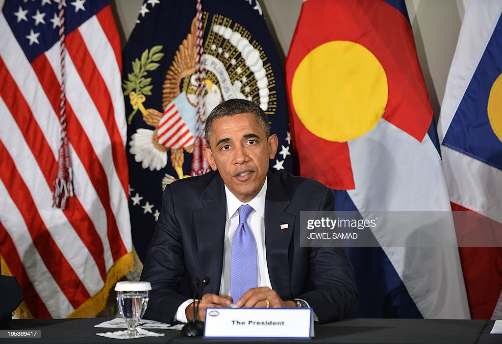 US President Barack Obama holds a meeting with local law enforcement officials and community leaders in Denver, Colorado, on April 3, 2013 as he continues asking the American people to join him in calling on Congress to pass common-sense measures to reduce gun violence. The president has demanded votes on measures including a requirement for background checks on all gun purchases, limits on high capacity ammunition magazines, a reinstated assault weapons ban, new gun trafficking laws, and new school safety plans. But the assault weapons ban push appears certain to fail to get sufficient support in the Senate, following a huge campaign by the gun lobby and opposition from Republicans and Democrats from conservative and rural areas. AFP PHOTO/Jewel Samad