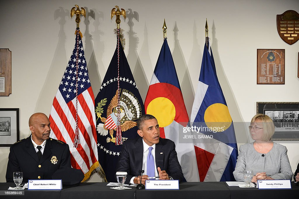 US President Barack Obama (C) holds a meeting with local law enforcement officials and community leaders in Denver, Colorado, on April 3, 2013 as he continues asking the American people to join him in calling on Congress to pass common-sense measures to reduce gun violence. The president has demanded votes on measures including a requirement for background checks on all gun purchases, limits on high capacity ammunition magazines, a reinstated assault weapons ban, new gun trafficking laws, and new school safety plans. But the assault weapons ban push appears certain to fail to get sufficient support in the Senate, following a huge campaign by the gun lobby and opposition from Republicans and Democrats from conservative and rural areas. AFP PHOTO/Jewel Samad