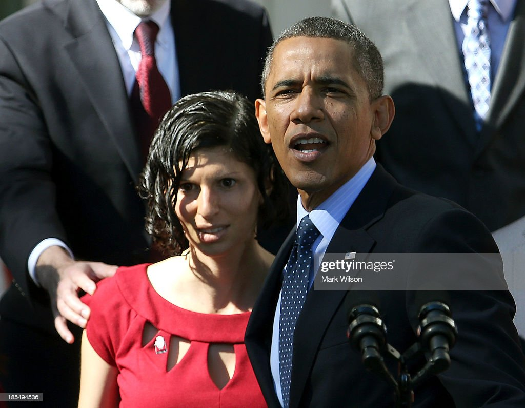 U.S. President <a gi-track='captionPersonalityLinkClicked' href=/galleries/search?phrase=Barack+Obama&family=editorial&specificpeople=203260 ng-click='$event.stopPropagation()'>Barack Obama</a> holds onto Karmel Allison who has Type 1 Diabetes and felt light headed while he was delivering remarks about the error-plagued launch of the Affordable Care Act's online enrollment website in the Rose Garden of the White House October 21, 2013 in Washington, DC. According to the White House, the president was joined by 'consumers, small business owners, and pharmacists who have either benefitted from the health care law already or are helping consumers learn about what the law means for them and how they can get covered. 'Despite the new health care law's website problems, Obama urged Americans not to be deterred from registering for Obamacare because of the technological problems that have plagued its rollout.