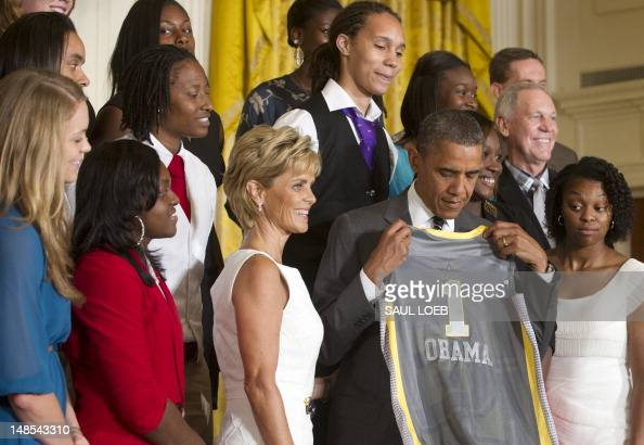 US President Barack Obama holds up a jersey during a ceremony honoring the 2012 NCAA Women's College Basketball Champion Baylor Bears in the East...