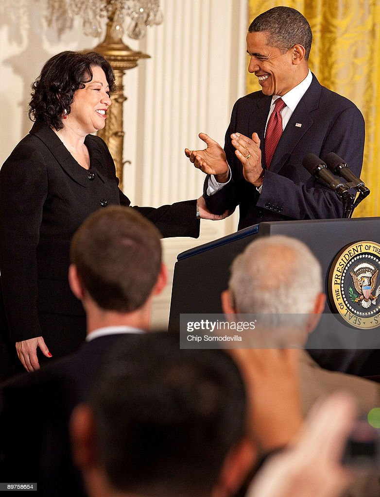 U.S. President Barack Obama (R) hosts a reception for new Supreme Court Associate Justice Sonia Sotomayor in the East Room of the White House August 12, 2009 in Washington, DC. Sotomayor, who is the first Hispanic and the third woman to be appointed to the Supreme Court, is expected to begin hearing oral arguments with the other justices in September.