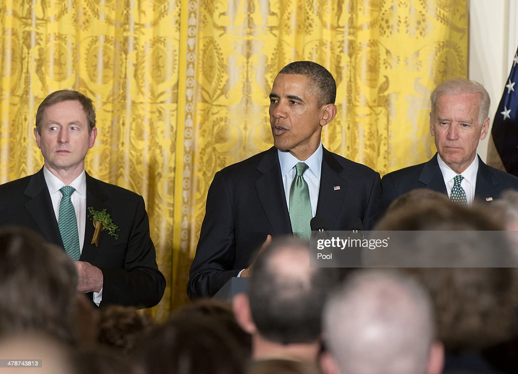 U.S. President <a gi-track='captionPersonalityLinkClicked' href=/galleries/search?phrase=Barack+Obama&family=editorial&specificpeople=203260 ng-click='$event.stopPropagation()'>Barack Obama</a> (C) hosts a St. Patrick's Day reception for Prime Minister <a gi-track='captionPersonalityLinkClicked' href=/galleries/search?phrase=Enda+Kenny&family=editorial&specificpeople=5129605 ng-click='$event.stopPropagation()'>Enda Kenny</a> (L) of Ireland in the East Room of the White House March 14, 2014 in Washington, DC. Vice President Joe Biden looks on at right.