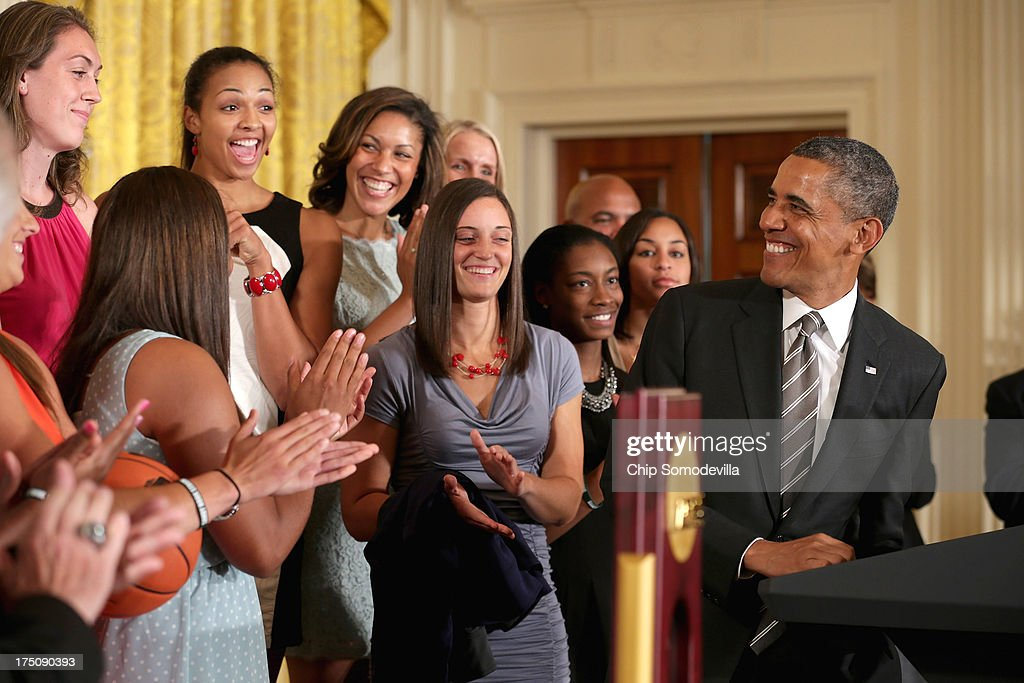 President Barack Obama (R) hosts the 2013 NCAA champion University of Connecticut Huskies Women's basketball players in the East Room of the White House July 31, 2013 in Washington, DC. Obama hosted the team after they defeated the University of Louisville on April 9 to win their eighth national championship.