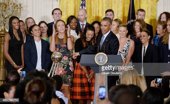 President Barack Obama hosts the WNBA champion Phoenix Mercury during an event in the East Room at the White House on August 26 2015 in Washington DC...