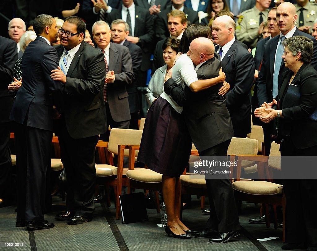 President Barack Obama hugs Daniel Hernandez Jr an intern of US Rep Gabrielle Giffords as first lady Michelle Obama hugs NASA astronaut Mark Kelly...