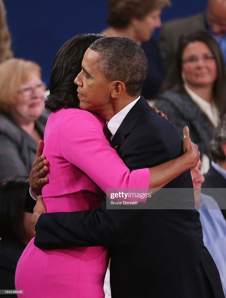 S President Barack Obama hugs his wife Michelle Obama after a town hall style presidential debate at Hofstra University October 16 2012 in Hempstead...