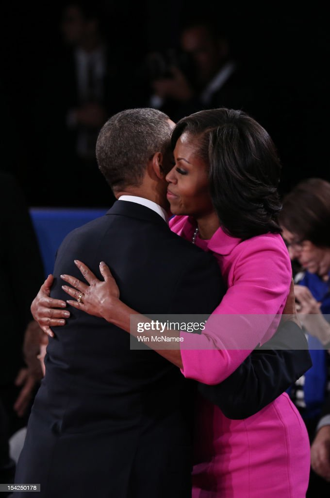 U.S. President <a gi-track='captionPersonalityLinkClicked' href=/galleries/search?phrase=Barack+Obama&family=editorial&specificpeople=203260 ng-click='$event.stopPropagation()'>Barack Obama</a> hugs <a gi-track='captionPersonalityLinkClicked' href=/galleries/search?phrase=Michelle+Obama&family=editorial&specificpeople=2528864 ng-click='$event.stopPropagation()'>Michelle Obama</a> after a town hall style debate with Republican presidential candidate Mitt Romney at Hofstra University October 16, 2012 in Hempstead, New York. During the second of three presidential debates, the candidates fielded questions from audience members on a wide variety of issues.
