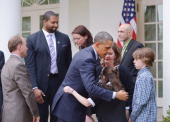 US President Barack Obama hugs Newtown shooting victim relative Natalie Barden as James Barden looks on after speaking on gun control on April 17...