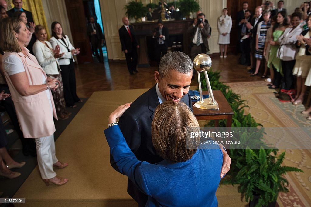 US President Barack Obama hugs Senator Amy Klobuchar (D-MN) after an event to celebrate the 2015 WNBA Champions, Minnesota Lynx, in the East Room of the White House June 27, 2016 in Washington, DC. / AFP / Brendan Smialowski