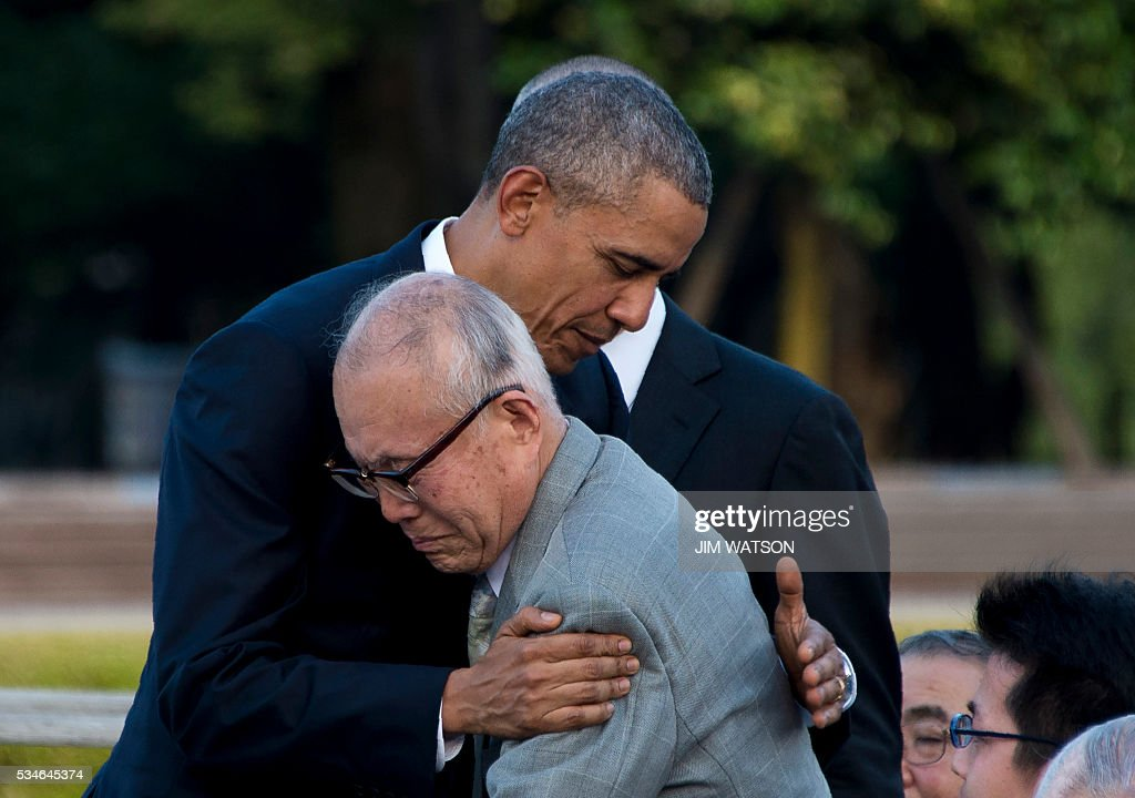 US President Barack Obama hugs Shigeaki Mori (front), a survivor of the 1945 atomic bombing of Hiroshima, during a visit to the Hiroshima Peace Memorial Park on May 27, 2016. Obama on May 27 paid moving tribute to victims of the world's first nuclear attack. WATSON