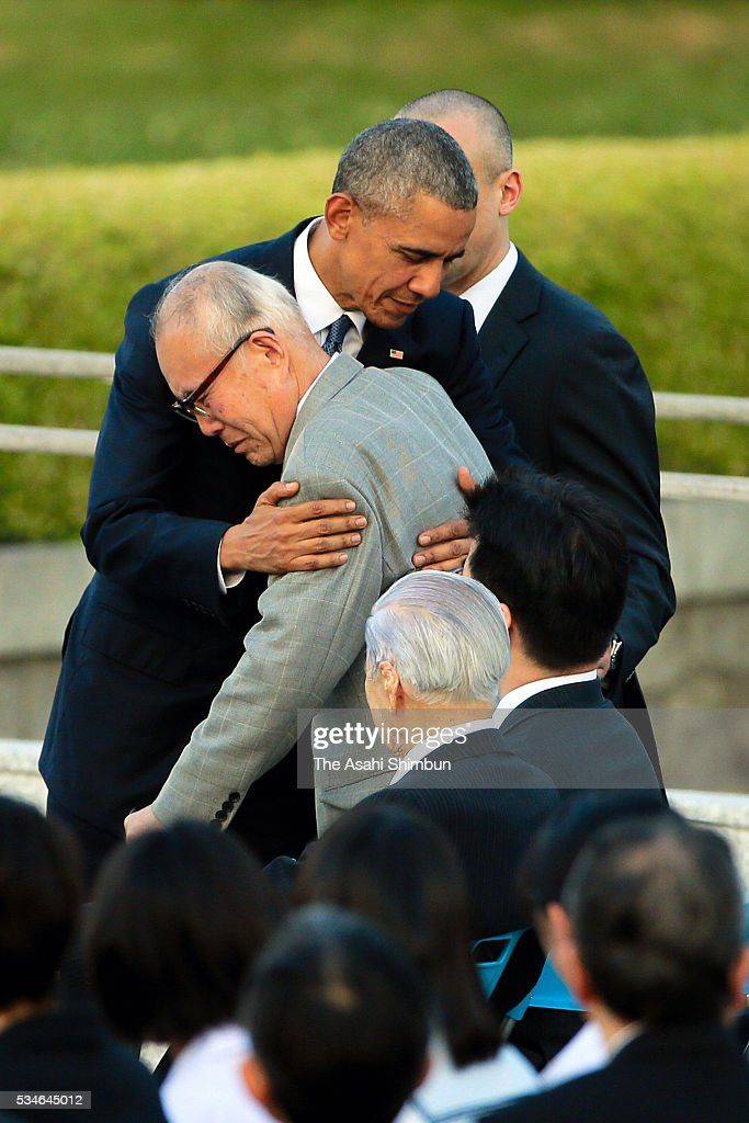 U.S. President <a gi-track='captionPersonalityLinkClicked' href=/galleries/search?phrase=Barack+Obama&family=editorial&specificpeople=203260 ng-click='$event.stopPropagation()'>Barack Obama</a> hugs Shigeaki Mori, historian and a-bomb survivor during his visit to the Hiroshima Peace Memorial Park on May 27, 2016 in Hiroshima, Japan. Obama becomes the first sitting U.S. president to visit Hiroshima, where the first atomic bomb was dropped in 1945 at the end of World War II.