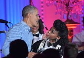 US President Barack Obama hugs singer Janelle Monáe during an Independence Day Celebration for military members and administration staff on July 4...