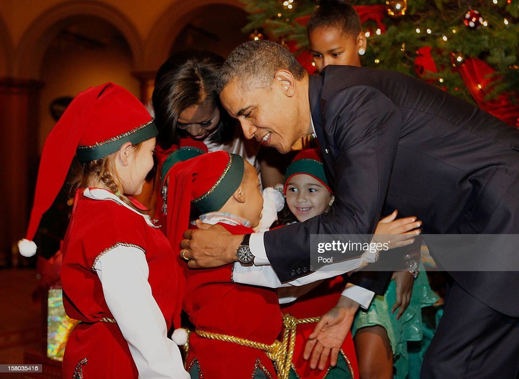 U.S. President <a gi-track='captionPersonalityLinkClicked' href=/galleries/search?phrase=Barack+Obama&family=editorial&specificpeople=203260 ng-click='$event.stopPropagation()'>Barack Obama</a> hugs the Christmas elves as they attend the 'Christmas in Washington' concert at the National Building Museum on December 9, 2012 in Washington, D.C. The concert benefits the National Childrens Medical Center and is hosted by comedian Conan O'Brien.