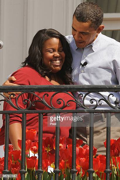 US President Barack Obama hugs TV show Glee's Amber Riley after she sang the national anthem the annual White House Easter Egg Roll at the South Lawn...