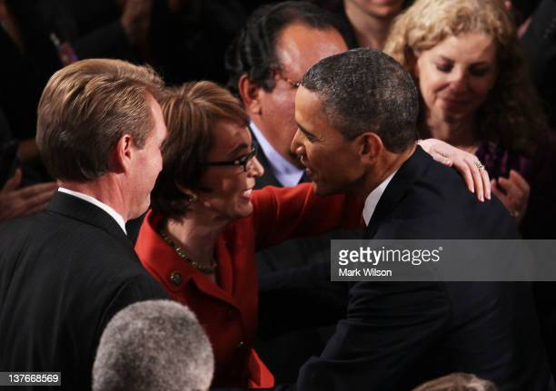 S President Barack Obama hugs US Rep Gabrielle Giffords before delivering his State of the Union speech on January 24 2012 in Washington DC Obama...