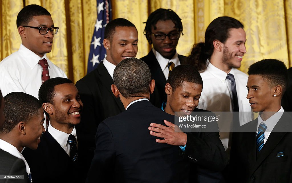 U.S. President <a gi-track='captionPersonalityLinkClicked' href=/galleries/search?phrase=Barack+Obama&family=editorial&specificpeople=203260 ng-click='$event.stopPropagation()'>Barack Obama</a> hugs young men who participate in the 'Becoming A Man' program in Chicago during an event in the East Room of the White House February 27, 2014 in Washington, DC. Obama signed an executive memorandum following remarks on the ÒMy BrotherÕs KeeperÓ initiative.
