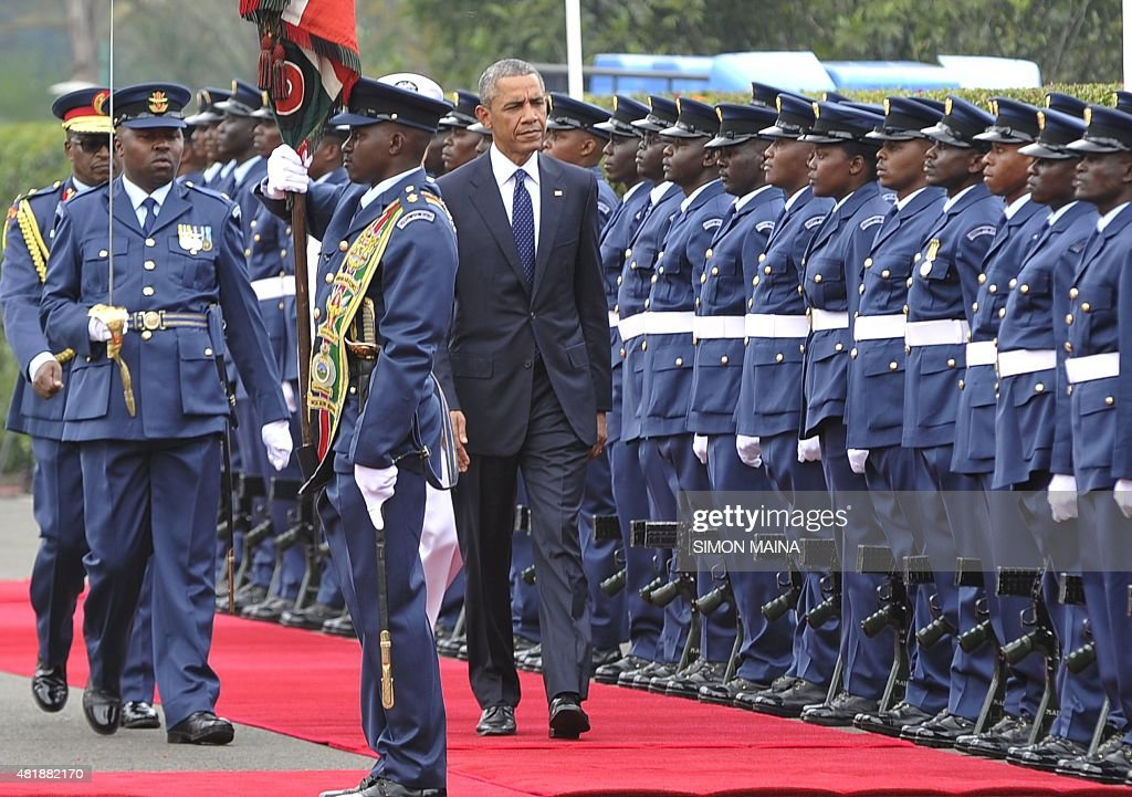 US President Barrack Obama inspects a guard of honour on July 25 2015 at the State House in Nairobi Obama arrived in Africa on a fiveday tour with...