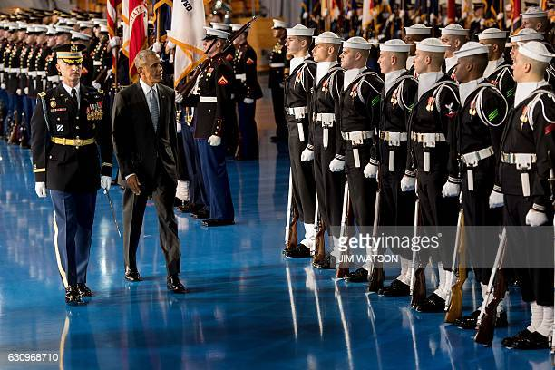 US President Barack Obama inspects US troops during an Armed Forces Full Honor Farewell Review at Joint Base MyerHenderson in Arlington Virginia...