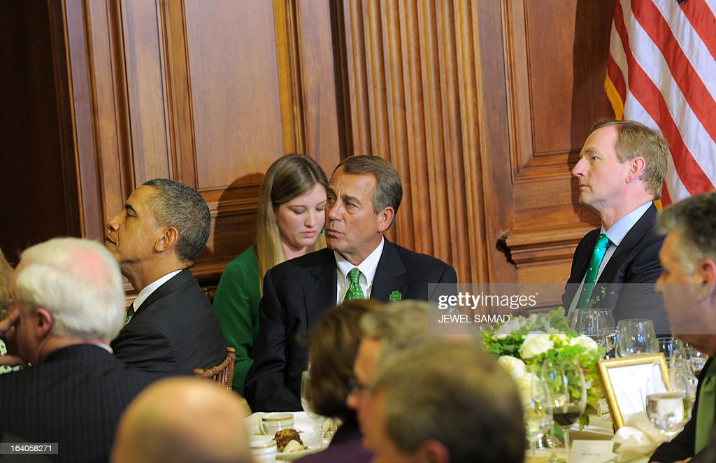 US President Barack Obama (L), Irish Prime Minister Enda Kenny (R) and US House Speaker John Boehner (C) attend a St. Patrick's Day lunch at the US Capitol in Washington, DC, on March 19, 2013. AFP PHOTO/Jewel Samad