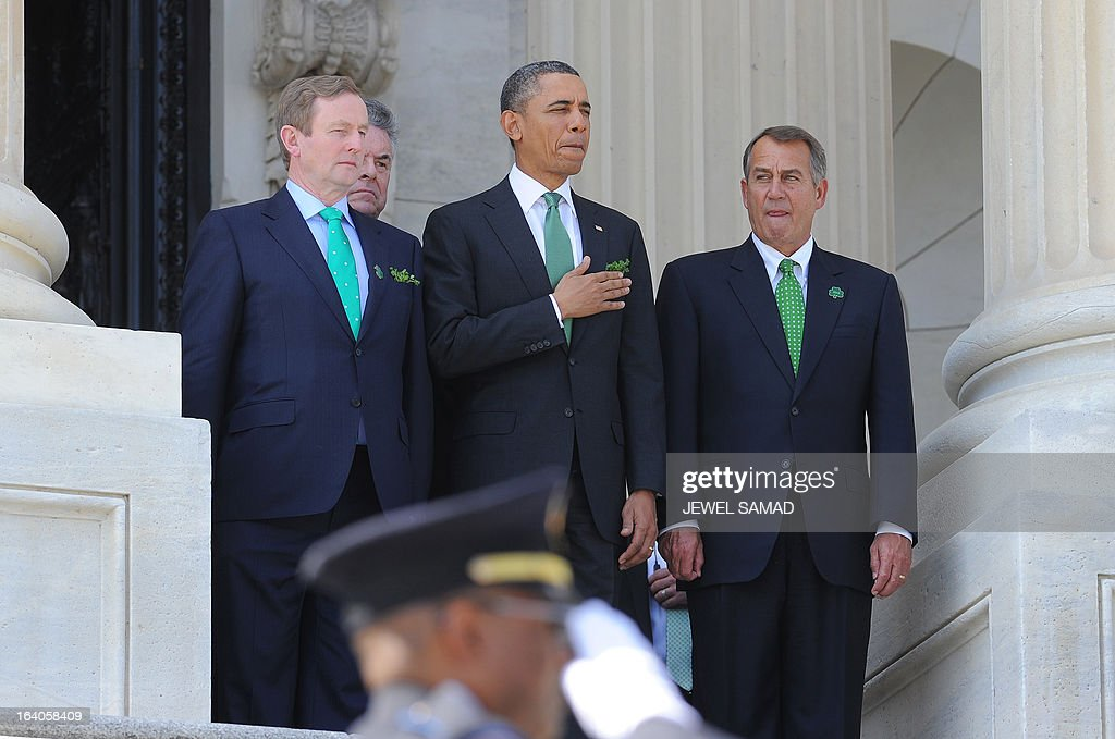US President Barack Obama (C), Irish Prime Minister Enda Kenny (L) and US House Speaker John Boehner leave the US Capitol after attending a St. Patrick's Day lunch in Washington, DC, on March 19, 2013. AFP PHOTO/Jewel Samad
