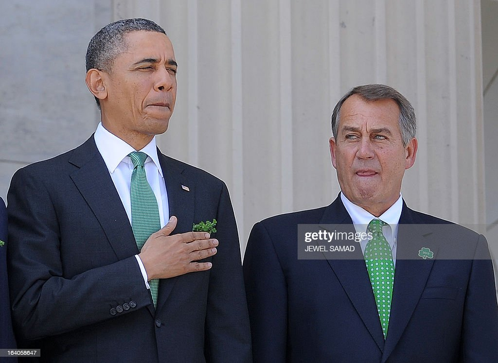 US President Barack Obama is accompanied by House Speaker John Boehner as he leaves the US Capitol after attending a St. Patrick's Day lunch along with Irish Prime Minister Enda Kenny in Washington, DC, on March 19, 2013. AFP PHOTO/Jewel Samad