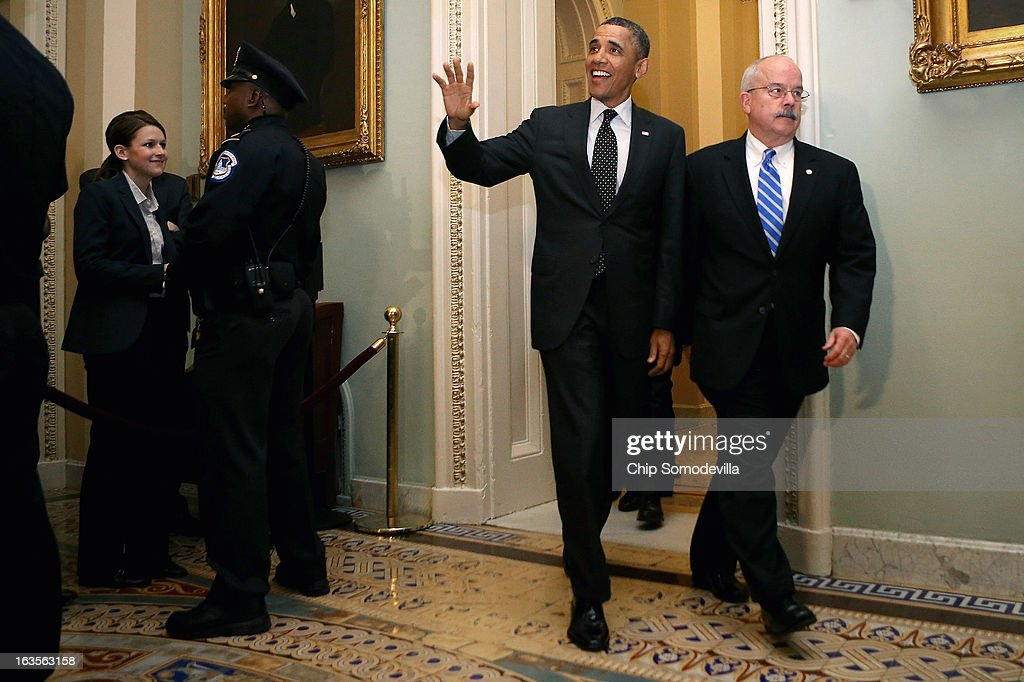 U.S. President Barack Obama is accompanied by Sergeant at Arms of the United States Senate Terrance Gainer as he arrives for a meeting with members of the Senate Democatic Caucus in the Mansfield Room at the U.S. Capitol March 12, 2013 in Washington, DC. With tax reform, spending cuts, gun control and immigration on the agenda, Obama will be holding four meetings over three days this week with Republican and Democratic members of Congress at the U.S. Capitol.