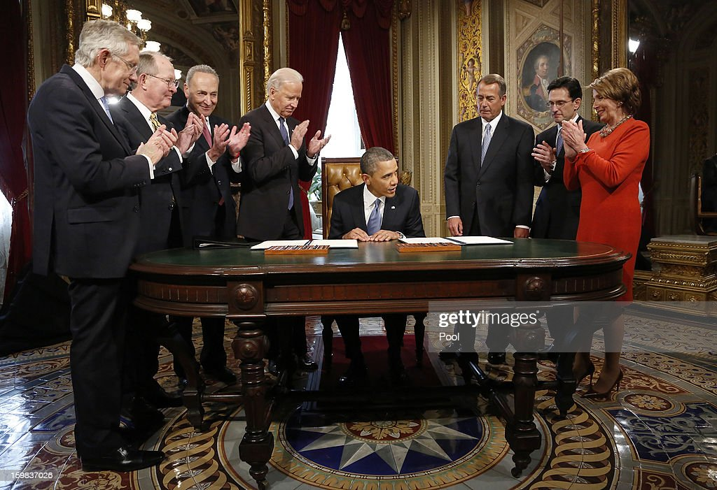 U.S. President Barack Obama (4R) is applauded by (L-R) Senate Majority Leader Sen. Harry Reid (D-NV), Sen. Lamar Alexander (R-TN), Sen. Chuck Schumer (D-NY), Vice President Joe Biden, House Speaker Rep. John Boehner (R-OH), House Majority Leader Rep. Eric Cantor (R-VA) and House Minority Leader Rep. Nancy Pelosi (D-CA) after signing a proclamation to commemorate the inauguration, entitled a National Day of Hope and Resolve, directly after swearing-in ceremonies in the U.S Capitol on January 21, 2013 in Washington, DC. U.S. President Barack Obama was ceremonially sworn in for his second term today.