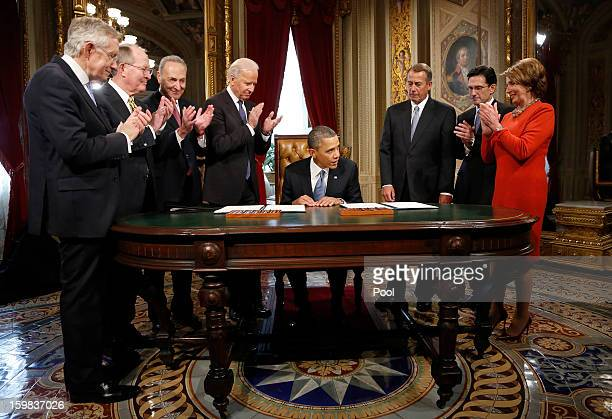S President Barack Obama is applauded by Senate Majority Leader Sen Harry Reid Sen Lamar Alexander Sen Chuck Schumer Vice President Joe Biden House...