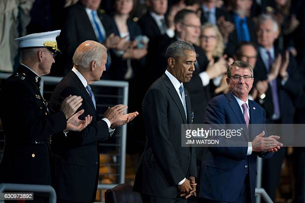 US President Barack Obama is applauded by US Secretary of Defense Ashton Carter Vice President Joe Biden and Chairman of the Joint Chiefs General...