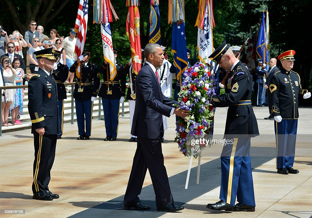 President <a gi-track='captionPersonalityLinkClicked' href=/galleries/search?phrase=Barack+Obama&family=editorial&specificpeople=203260 ng-click='$event.stopPropagation()'>Barack Obama</a> is assisted as he lays a wreath at the Tomb of the Unknown Soldier at Arlington National Cemetery on May 30, 2016 in Arlington, Virginia. Obama paid tribute to the nation's fallen military service members.