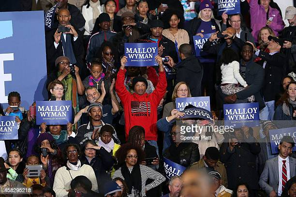 S President Barack Obama is cheered as he walks onto stage to speak in support of Connecticut Governor Dan Malloy on November 2 2014 in Bridgeport...