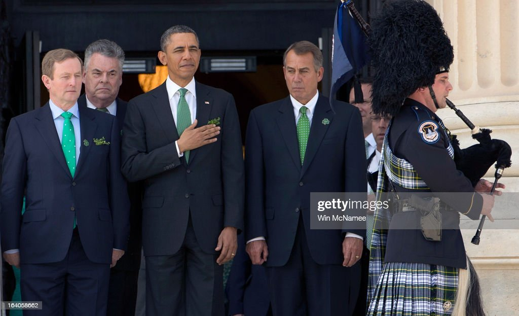 S President Barack Obama is escorted by Irish Prime Minister Edna Kenny Rep Peter King and US Speaker of the House John Boehner as a bagpiper plays...