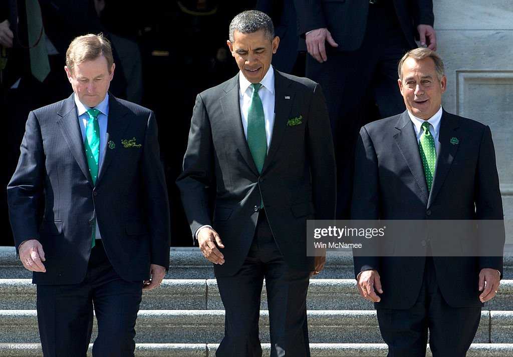 U.S. President <a gi-track='captionPersonalityLinkClicked' href=/galleries/search?phrase=Barack+Obama&family=editorial&specificpeople=203260 ng-click='$event.stopPropagation()'>Barack Obama</a> (C) is escorted by Irish Prime Minister Edna Kenny (L) and U.S. Speaker of the House <a gi-track='captionPersonalityLinkClicked' href=/galleries/search?phrase=John+Boehner&family=editorial&specificpeople=274752 ng-click='$event.stopPropagation()'>John Boehner</a> (R-OH) (R) while leaving the U.S. Capitol on March 19, 2013 in Washington, DC. Obama and Kenny attended the annual Friends of Ireland luncheon, which usually coincides with St. Patricks's Day, hosted by the House of Representatives at the U.S. Capitol.