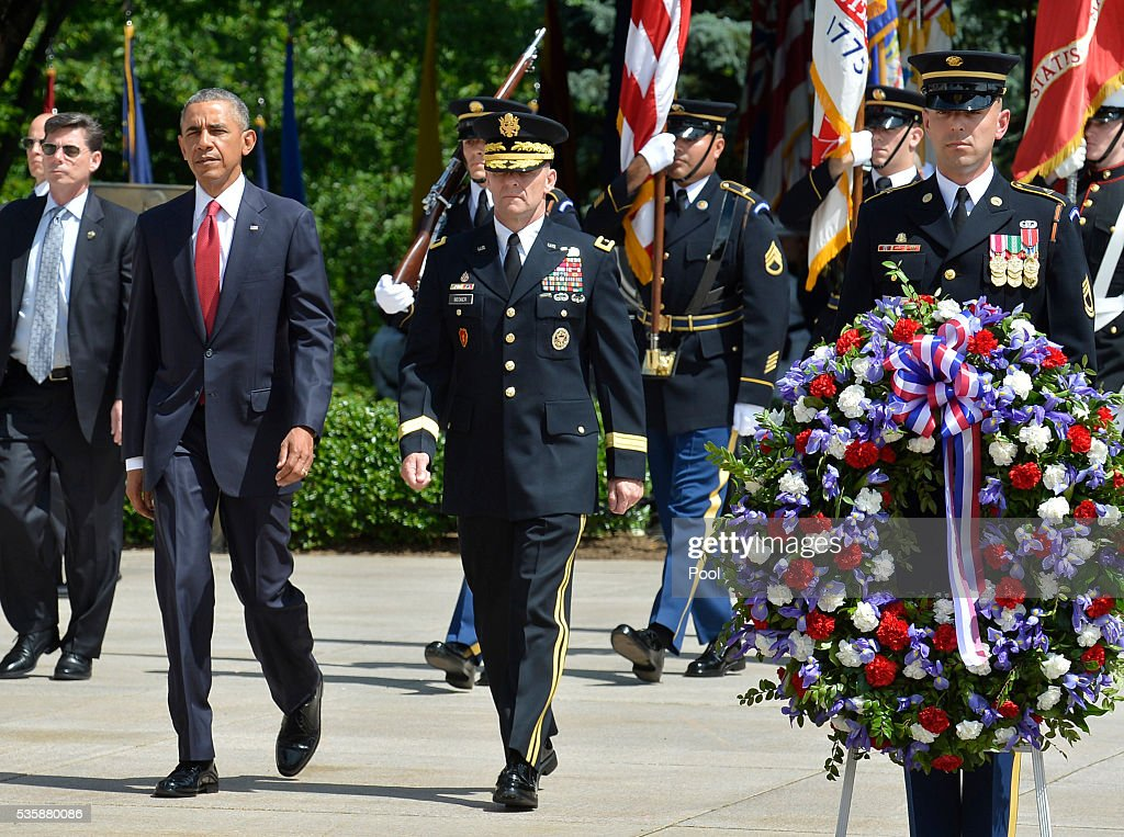 President Barack Obama is escorted by Major General Bradley A. Becker as they arrive to lay a wreath at the Tomb of the Unknown Soldier at Arlington National Cemetery on May 30, 2016 in Arlington, Virginia. Obama paid tribute to the nation's fallen military service members.