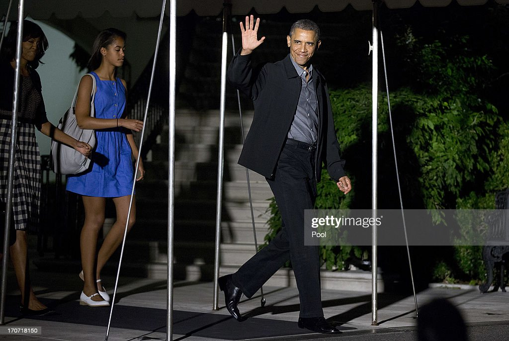 U.S. President <a gi-track='captionPersonalityLinkClicked' href=/galleries/search?phrase=Barack+Obama&family=editorial&specificpeople=203260 ng-click='$event.stopPropagation()'>Barack Obama</a> is followed by first lady <a gi-track='captionPersonalityLinkClicked' href=/galleries/search?phrase=Michelle+Obama&family=editorial&specificpeople=2528864 ng-click='$event.stopPropagation()'>Michelle Obama</a> and their daughter Malia walk to Marine One as they depart the White House on June 16, 2013 in Washington, DC. Obama is traveling to Northern Ireland to take part in the G8 Summit.