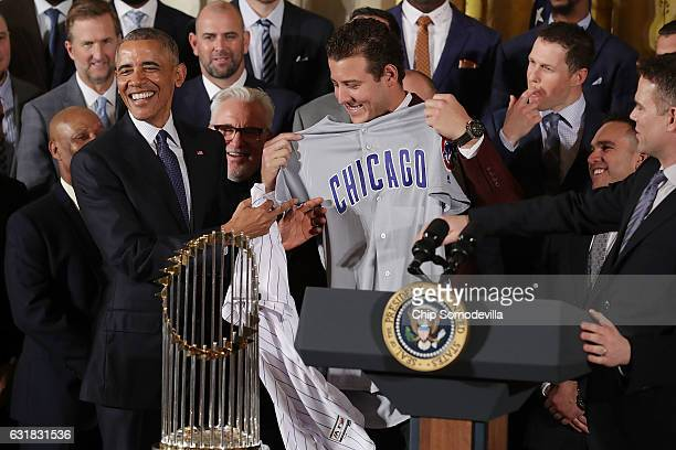 S President Barack Obama is given a uniform by Major League Baseball World Series champion Chicago Cubs player Anthony Rizzo during a celebration of...