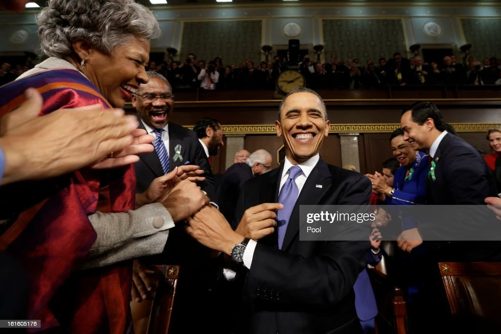 U.S. President <a gi-track='captionPersonalityLinkClicked' href=/galleries/search?phrase=Barack+Obama&family=editorial&specificpeople=203260 ng-click='$event.stopPropagation()'>Barack Obama</a> is greeted before his State of the Union address during a joint session of Congress on Capitol Hill on February 12, 2013 in Washington, D.C. Facing a divided Congress, Obama is expected to focus his speech on new initiatives designed to stimulate the U.S. economy.