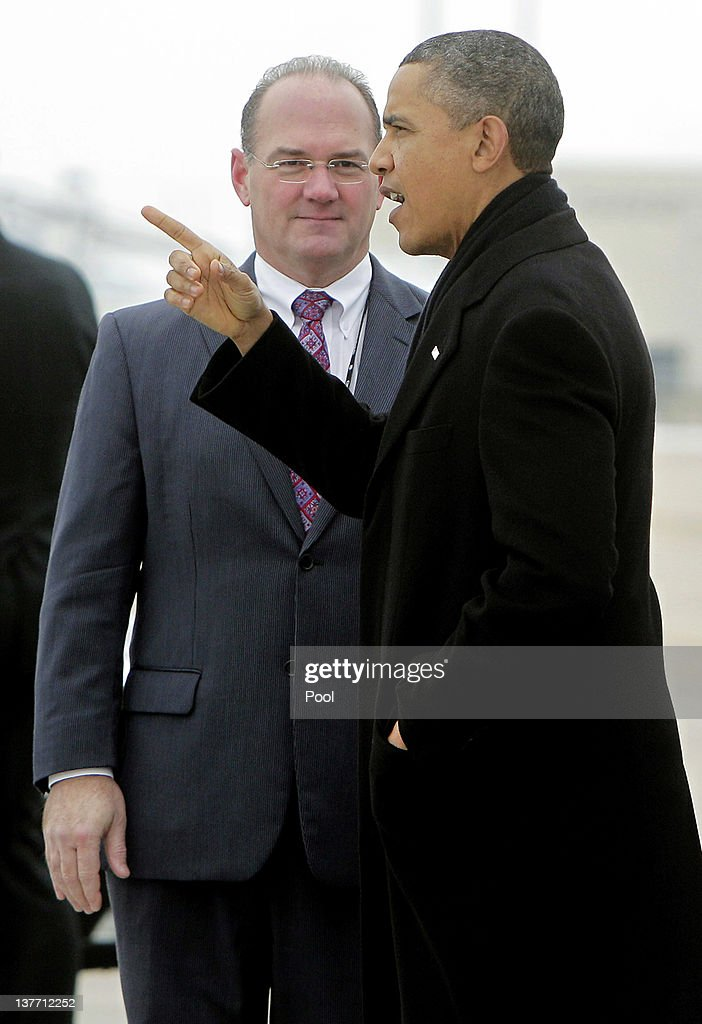 U.S. President <a gi-track='captionPersonalityLinkClicked' href=/galleries/search?phrase=Barack+Obama&family=editorial&specificpeople=203260 ng-click='$event.stopPropagation()'>Barack Obama</a> is greeted by Cedar Rapids Mayor Ron Corbett after arriving at The Eastern Iowa Airport on January 25, 2012 in Cedar Rapids, Iowa. Obama, who is on a three-day tour, spoke about manufacturing and the economy during the speech.