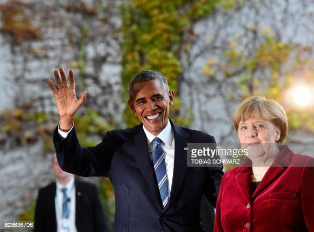 President Barack Obama is greeted by German Chancellor Angela Merkel upon arrival at the chancellery on November 17 2016 in Berlin US President...