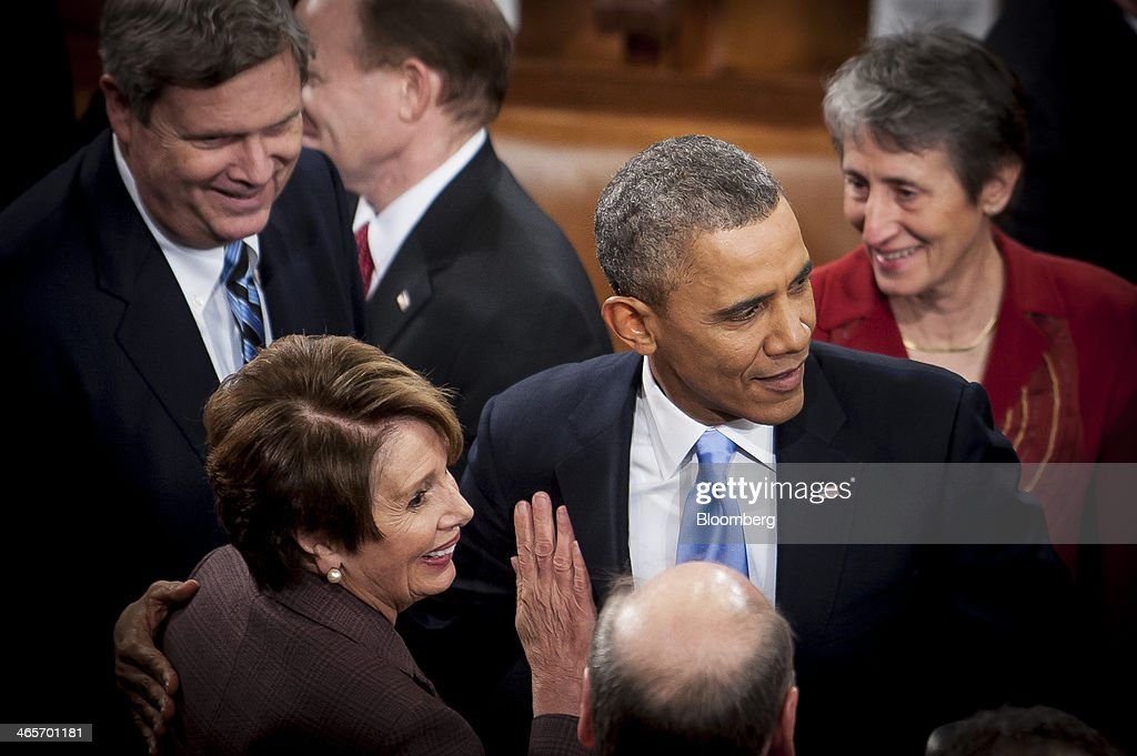U.S. President Barack Obama is greeted by House Minority Leader Nancy Pelosi, a Democrat from California, following the State of the Union address to a joint session of Congress at the Capitol in Washington, D.C., U.S., on Tuesday, Jan. 28, 2014. President Barack Obama urged Congress to back two priorities for U.S. multinational corporations: broader authority for his administration to negotiate trade deals, and changes to immigration laws. Photographer: Pete Marovich/Bloomberg via Getty Images