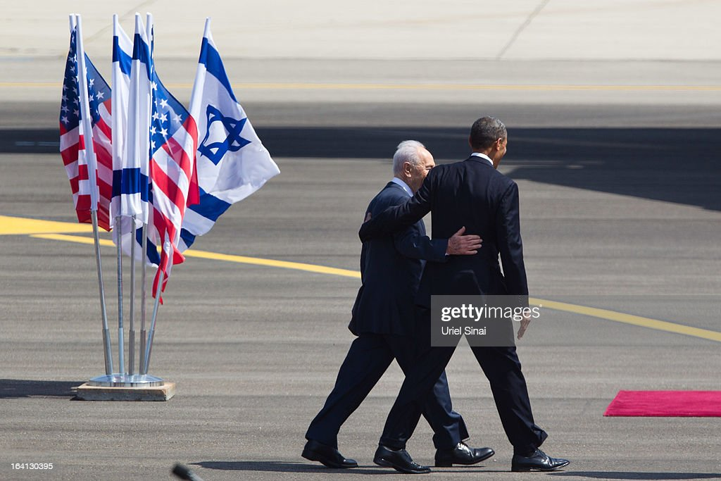 US President <a gi-track='captionPersonalityLinkClicked' href=/galleries/search?phrase=Barack+Obama&family=editorial&specificpeople=203260 ng-click='$event.stopPropagation()'>Barack Obama</a> is greeted by Israeli President <a gi-track='captionPersonalityLinkClicked' href=/galleries/search?phrase=Shimon+Peres&family=editorial&specificpeople=201775 ng-click='$event.stopPropagation()'>Shimon Peres</a> during an official welcoming ceremony on his arrival at Ben Gurion International Airport on March, 20, 2013 near Tel Aviv, Israel. This will be Obama's first visit as President to the region, and his itinerary will include meetings with the Palestinian and Israeli leaders as well as a visit to the Church of the Nativity in Bethlehem.