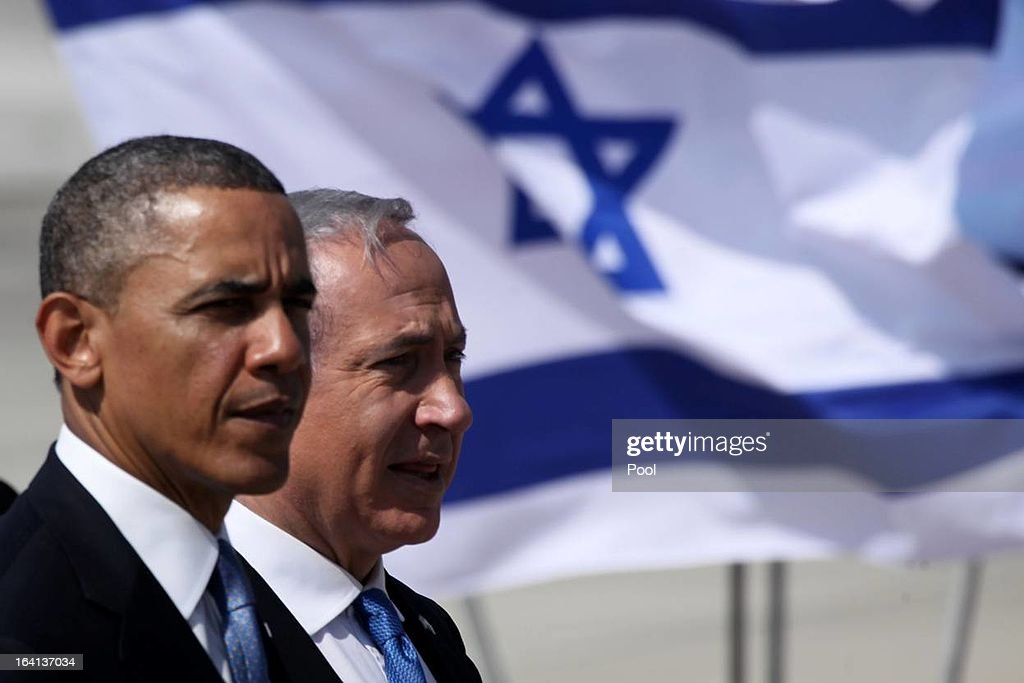 U.S. President <a gi-track='captionPersonalityLinkClicked' href=/galleries/search?phrase=Barack+Obama&family=editorial&specificpeople=203260 ng-click='$event.stopPropagation()'>Barack Obama</a> (L) is greeted by Israeli Prime Minister <a gi-track='captionPersonalityLinkClicked' href=/galleries/search?phrase=Benjamin+Netanyahu&family=editorial&specificpeople=118594 ng-click='$event.stopPropagation()'>Benjamin Netanyahu</a> during an official welcoming ceremony on his arrival at Ben Gurion International Airport on March, 20, 2013 near Tel Aviv, Israel. This will be Obama's first visit as president to the region, and his itinerary will include meetings with the Palestinian and Israeli leaders as well as a visit to the Church of the Nativity in Bethlehem.