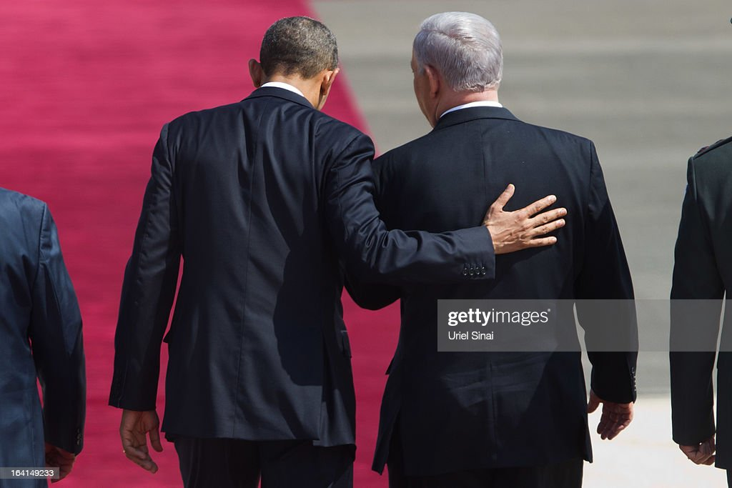 U.S. President Barack Obama (L) is greeted by Israeli Prime Minister Benjamin Netanyahu during an official welcoming ceremony on his arrival at Ben Gurion International Airport on March 20, 2013 near Tel Aviv, Israel. This will be Obama's first visit as President to the region, and his itinerary will include meetings with the Palestinian and Israeli leaders as well as a visit to the Church of the Nativity in Bethlehem.