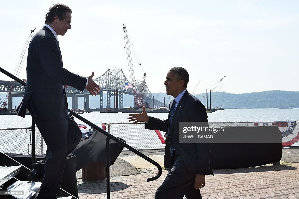 US President Barack Obama is greeted by New York governor Andrew Cuomo as he arrives to speak on the need for a '21st Century Transportation Infrastructure' in Tarrytown, New York, on May 14, 2014. AFP PHOTO/Jewel Samad