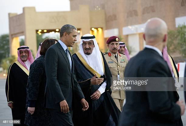 US President Barack Obama is greeted by Saudi Crown Prince Salman bin Abdulaziz alSaud upon his arrival at Rawdat Khurayim the monarch's desert camp...