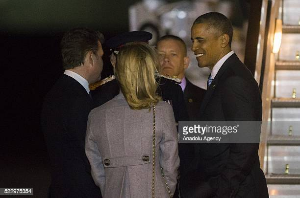 S President Barack Obama is greeted by US ambassador Matthew Barzun and his spouse Brooke Brown after he left US presidential plane Air Force One as...